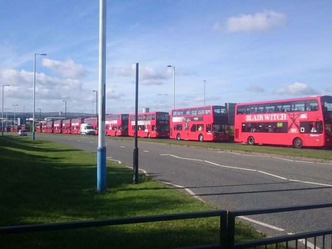 38 buses all transporting luggage to the finish line of the GNR. Sadly no participants wanted to be in the photo.