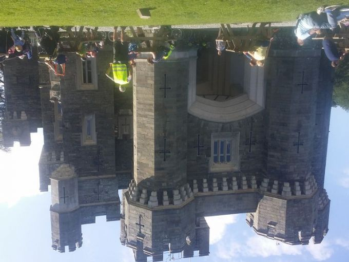 Wide view of Wray Castle  with Sky riders  participants in the foreground.